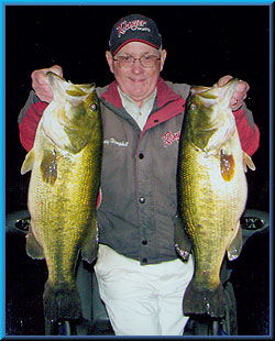 Larry Hemphill aka Lunker Larry with a 10lb. 2oz. and 9lb. 9oz. bass, part of a 42.5lb. limit. November 2008, Clear Lake